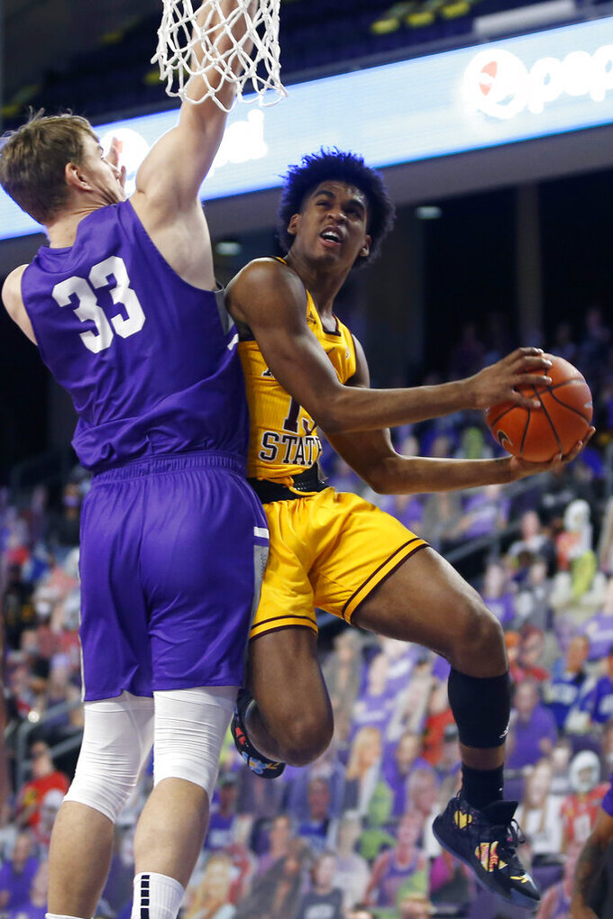 CORRECTS MONTH TO DEC. NOT JAN. - Arizona State guard Josh Christopher (13) drives to the basket as Grand Canyon center Asbjorn Midtgaard (33) defends during the first half of an NCAA college basketball game, Sunday, Dec. 13, 2020, in Phoenix. (AP Photo/Ralph Freso)