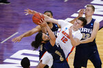 Oral Roberts guard Kareem Thompson, left, grabs a rebound in front of Florida forward Colin Castleton (12) during the second half of a college basketball game in the second round of the NCAA tournament at Indiana Farmers Coliseum, Sunday, March 21, 2021 in Indianapolis. (AP Photo/AJ Mast)