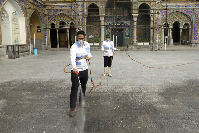 Workers disinfect the shrine of the Shiite Saint Imam Abdulazim to help prevent the spread of the new coronavirus in Shahr-e-Ray, south of Tehran, Iran, Saturday, March, 7, 2020. (AP Photo/Ebrahim Noroozi)