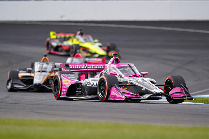 Alexander Rossi drives through a turn during an IndyCar auto race at Indianapolis Motor Speedway in Indianapolis, Saturday, Oct. 3, 2020. (AP Photo/Michael Conroy)