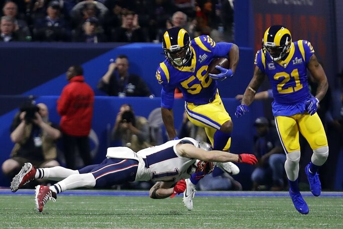 Los Angeles Rams' Cory Littleton (58) intercepts a pass as New England Patriots' Julian Edelman (11) attempts the tackle, during the first half of the NFL Super Bowl 53 football game Sunday, Feb. 3, 2019, in Atlanta. (AP Photo/Lynne Sladky)