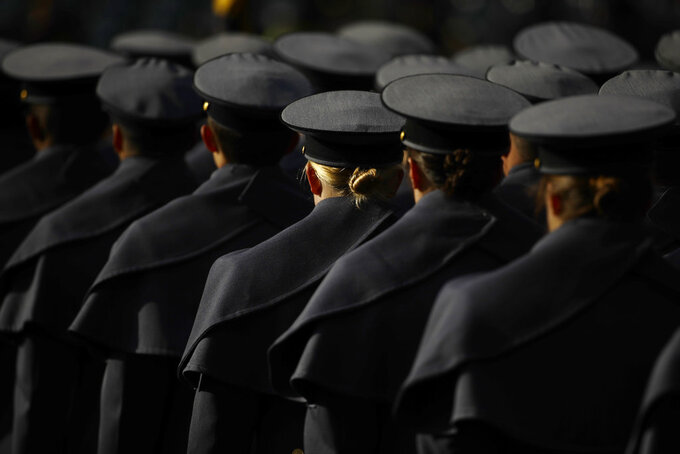 Army cadets march onto the field ahead of an NCAA college football against Navy, Saturday, Dec. 8, 2018, in Philadelphia. (AP Photo/Matt Rourke)