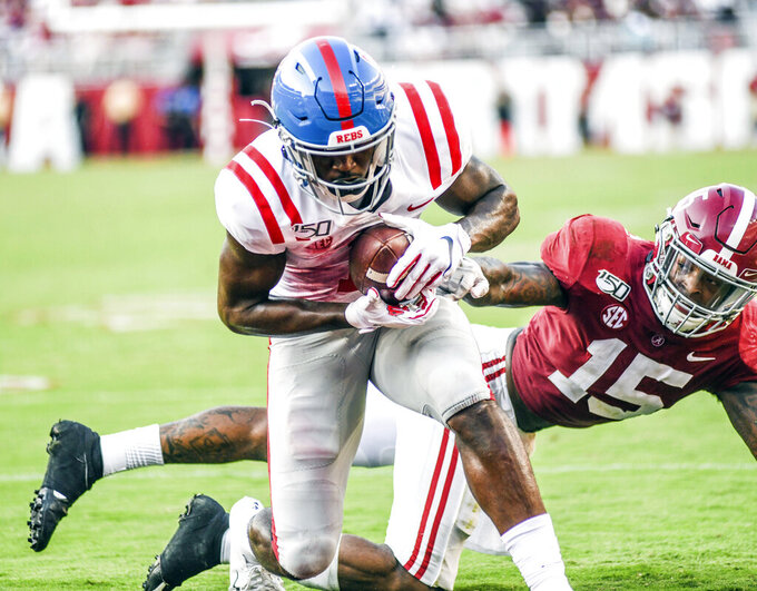 Mississippi wide receiver Jonathan Mingo, left, gets away from Alabama defensive back Xavier McKinney (15) for a touchdown catch during an NCAA college football game in Tuscaloosa, Ala., Saturday, Sept. 28, 2019. (Bruce Newman/The Oxford Eagle via AP)
