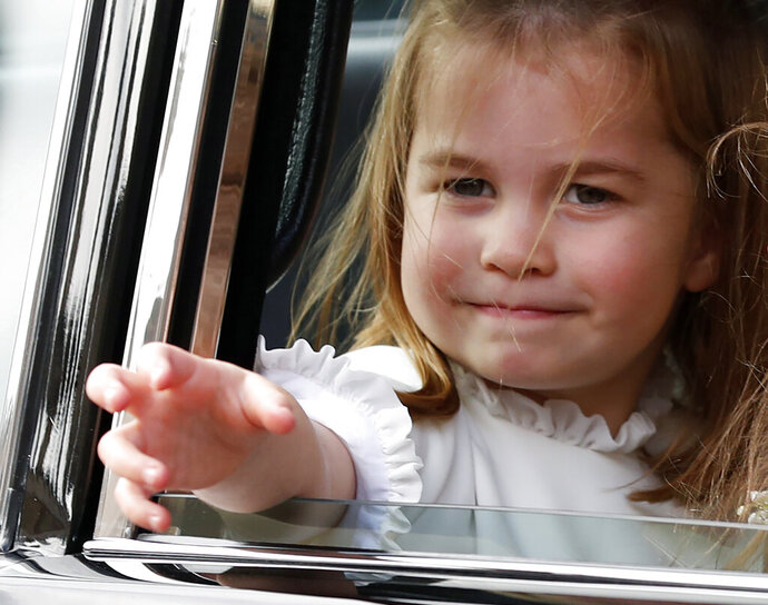 FILE - In this file photo dated  Friday, Oct. 12, 2018, Britain's Princess Charlotte waves following the wedding of Princess Eugenie of York and Jack Brooksbank at St George's Chapel in Windsor Castle, near London, England. Kensington Palace said Thursday Aug. 29, 2019, that the four-year-old daughter of Prince William and Catherine, Duchess of Cambridge, Princess Charlotte will attend her first day of school upcoming Sept. 5.(AP Photo/Alastair Grant, FILE)