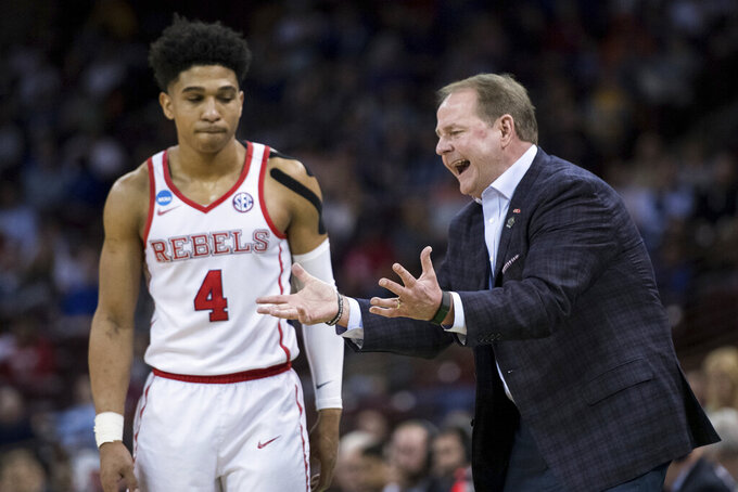 Mississippi head coach Kermit Davis communicates with Mississippi guard Breein Tyree (4) during a first round men's college basketball game in the NCAA Tournament Friday, March 22, 2019, in Columbia, S.C. (AP Photo/Sean Rayford)