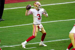 San Francisco 49ers quarterback C.J. Beathard (3) throws against the Seattle Seahawks during the first half of an NFL football game, Sunday, Jan. 3, 2021, in Glendale, Ariz. (AP Photo/Ross D. Franklin)