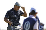 United States' Bryson DeChambeau reacts to the crowd after putting on the 1st green during the first round British Open Golf Championship at Royal St George's golf course Sandwich, England, Thursday, July 15, 2021. (AP Photo/Ian Walton)