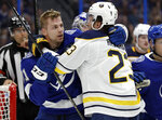 Tampa Bay Lightning defenseman Erik Cernak (81), of Slovakia, and Buffalo Sabres center Sam Reinhart (23) square off during the first period of an NHL hockey game Thursday, Feb. 21, 2019, in Tampa, Fla. (AP Photo/Chris O'Meara)