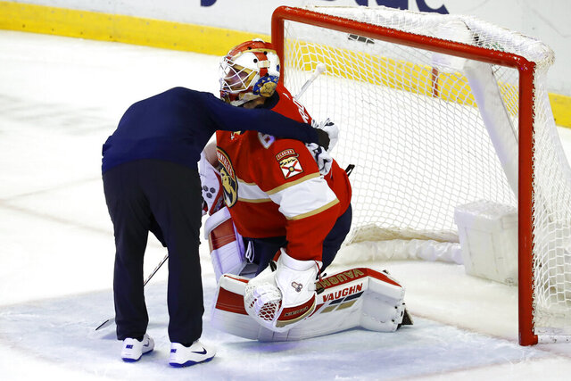 Florida Panthers goaltender Chris Driedger is helped off the ice during the first period of the team's NHL hockey game against the Los Angeles Kings, Thursday, Jan. 16, 2020, in Sunrise, Fla. (AP Photo/Brynn Anderson)