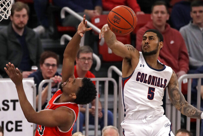 Robert Morris' AJ Bramah (5) blocks a shot by St. Francis' Keith Braxton during the first half of an NCAA college basketball game for the Northeast Conference men's tournament championship in Pittsburgh, Tuesday, March 10, 2020. (AP Photo/Gene J. Puskar)