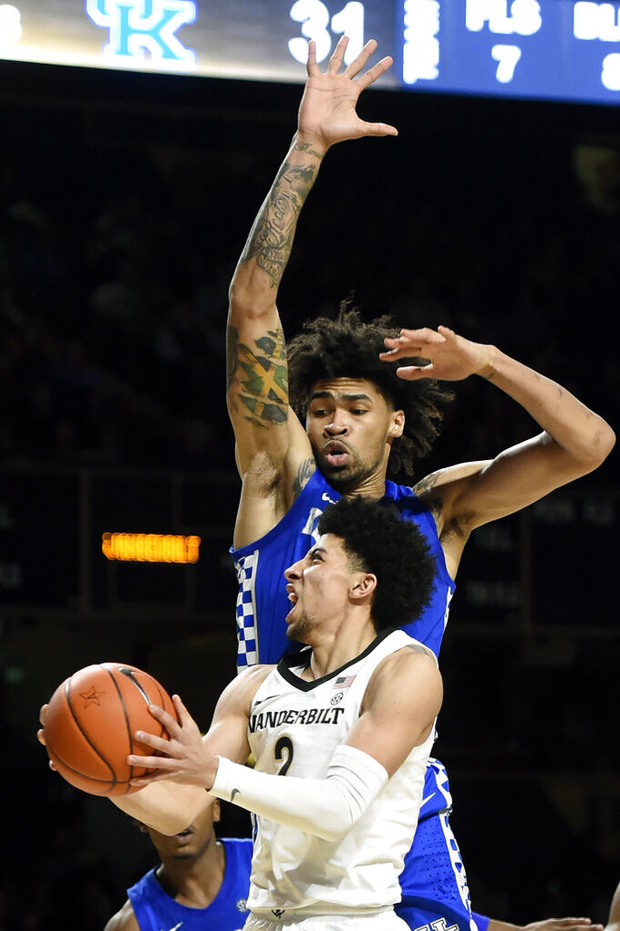 Vanderbilt guard Scotty Pippen Jr. (2) drives past Kentucky forward Nick Richards, top, during the second half of an NCAA college basketball game Tuesday, Feb. 11, 2020, in Nashville, Tenn. Kentucky won 78-64. (AP Photo/Mark Zaleski)
