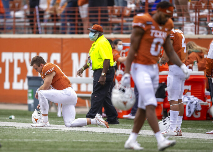 Texas quarterback Sam Ehlinger (11) looks down after watching kicker Cameron Dicker (17) miss a field goal that would have sent the game into overtime during an NCAA college football game against against Iowa State, Saturday, Nov. 27, 2020, in Austin, Texas. (Ricardo B. Brazziell/Austin American-Statesman via AP)