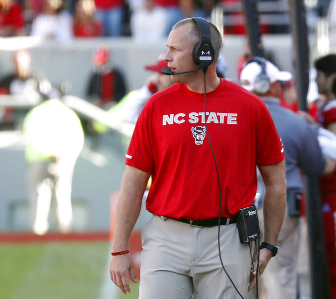 North Carolina State head coach Dave Doeren watches the action during the first half of an NCAA college football game against Florida State in Raleigh, N.C., Saturday, Nov. 3, 2018. (AP Photo/Chris Seward)