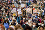 People gather for a Fridays for Future global climate strike in Berlin, Germany, Friday, Sept. 24, 2021. (AP Photo/Markus Schreiber)