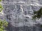 FILE - This June 23, 2015, file photo shows a carving depicting Confederate Civil War figures Stonewall Jackson, Robert E. Lee and Jefferson Davis, in Stone Mountain, Ga.  The Stone Mountain Memorial Association has denied a gathering permit from the Sons of Confederate Veterans, who were looking to host their annual Confederate Memorial Day service at Stone Mountain Park outside Atlanta.  The gathering was slated for Saturday, April 17, 2021,  but a March 31 letter from memorial association CEO Bill Stephens denied the necessary permit, The Atlanta Journal-Constitution reported.  (AP Photo/John Bazemore, File)