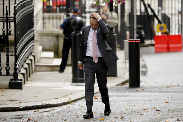 British Health Secretary Matt Hancock walks through Downing Street on his way into number 10, in London, Wednesday, Sept. 23, 2020. British Prime Minister Boris Johnson appealed Tuesday for resolve and a