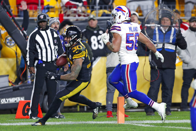 Pittsburgh Steelers running back James Conner (30) scores with Buffalo Bills outside linebacker Matt Milano (58) defending during the second half of an NFL football game in Pittsburgh, Sunday, Dec. 15, 2019. (AP Photo/Keith Srakocic)