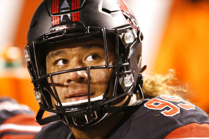 FILE - In this Oct. 26, 2019, file photo, Utah defensive tackle Leki Fotu (99) looks at the scoreboard as he sits on the bench in the second half in an NCAA college football game against California, in Salt Lake City. Fotu was selected to The Associated Press All-Pac 12 Conference team, Thursday, Dec. 12, 2019. (AP Photo/Rick Bowmer, File)