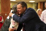 DELETES INCORRECT NAME OF PRIMARY WINNER - Kris Kobach, who was running for the Republican nomination to the U.S. Senate, hugs a supporter after conceding the race, Tuesday, Aug. 4, 2020, in Leavenworth, Kan. (AP Photo/Orlin Wagner)