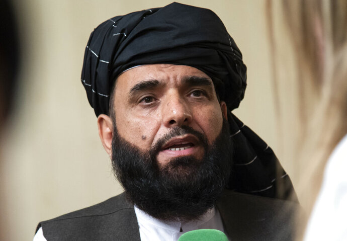 FILE - In this May 28, 2019 file photo, Suhail Shaheen, spokesman for the Taliban's political office in Doha, speaks to the media in Moscow, Russia. The Taliban are warning the Afghan government against any attacks on Taliban members who are to be freed from prison in the final prisoner release under a U.S.-Taliban deal. Shaheen said Tuesday, Aug. 11, 2020, that such attacks would jeopardize peace talks between the Taliban and the Kabul political leadership. (AP Photo/Alexander Zemlianichenko, File)