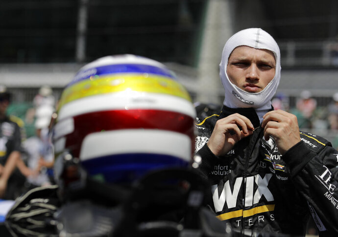 FILE -  In this May 20, 2018, file photo, Sage Karam prepares for qualifications for the IndyCar Indianapolis 500 auto race at Indianapolis Motor Speedway in Indianapolis. At just 20, Karam had already landed his dream gig; a seat in the powerhouse Chip Ganassi Racing's IndyCar program. Four years later, Karam is hoping to prove that he deserves another shot at a full-time seat in the series. (AP Photo/Darron Cummings, File)