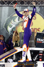Denny Hamlin celebrates after winning the NASCAR Cup Series auto race Saturday, Aug. 17, 2019, in Bristol, Tenn. (AP Photo/Wade Payne)
