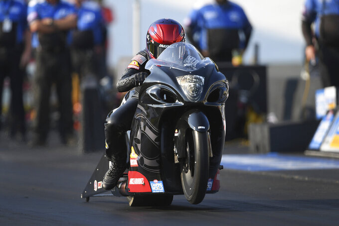 In this photo provided by the NHRA, Angelle Sampey drives in Pro Stock Motorcycle qualifying Friday, Sept. 10, 2021, at the Mopar Express Lane NHRA Nationals at Maple Grove Raceway in Mohnton, Pa. (Marc Gewertz/NHRA via AP)