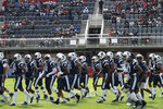 Howard football players take the field before an NCAA college football game between Howard and Hampton at Audi Field in Washington, Saturday, Sept. 18, 2021. (AP Photo/Cliff Owen)