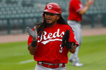 Cincinnati Reds' Freddy Galvis celebrates after scoring against the Detroit Tigers in the seventh inning of the first baseball game of a doubleheader in Detroit, Sunday, Aug. 2, 2020. (AP Photo/Paul Sancya)