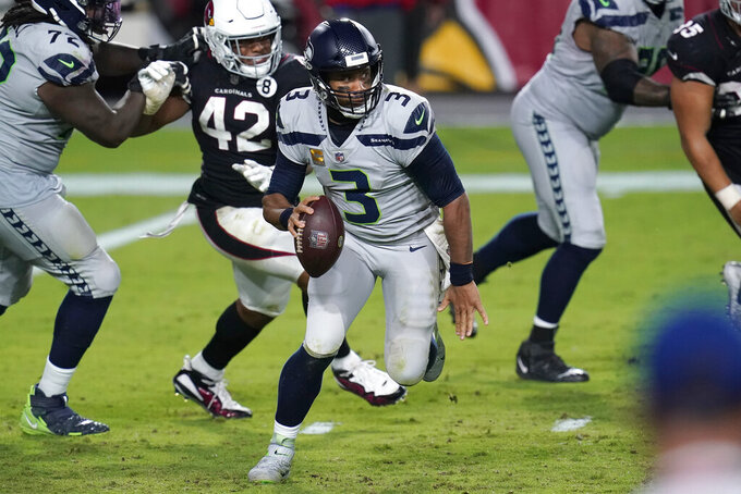 Seattle Seahawks quarterback Russell Wilson (3) scrambles as Arizona Cardinals outside linebacker Devon Kennard (42) pursues during the second half of an NFL football game, Sunday, Oct. 25, 2020, in Glendale, Ariz. (AP Photo/Ross D. Franklin)
