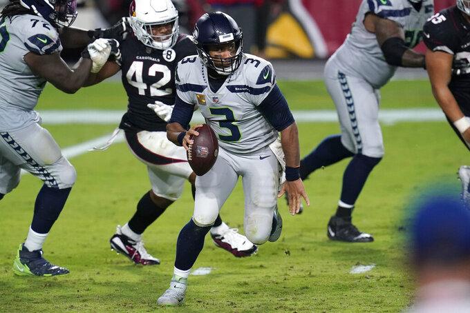 Seattle Seahawks quarterback Russell Wilson (3) scrambles as Arizona Cardinals outside linebacker Devon Kennard (42) pursues during the second half of an NFL football game, Sunday, Oct. 25, 2020, in Glendale, Ariz. (AP Photo/Ross D. Franklin)