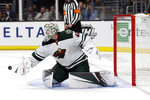 Minnesota Wild goaltender Devan Dubnyk (40) stops a shot against the Los Angeles Kings during the second period of an NHL hockey game Tuesday, Nov. 12, 2019, in Los Angeles. (AP Photo/Marcio Jose Sanchez)