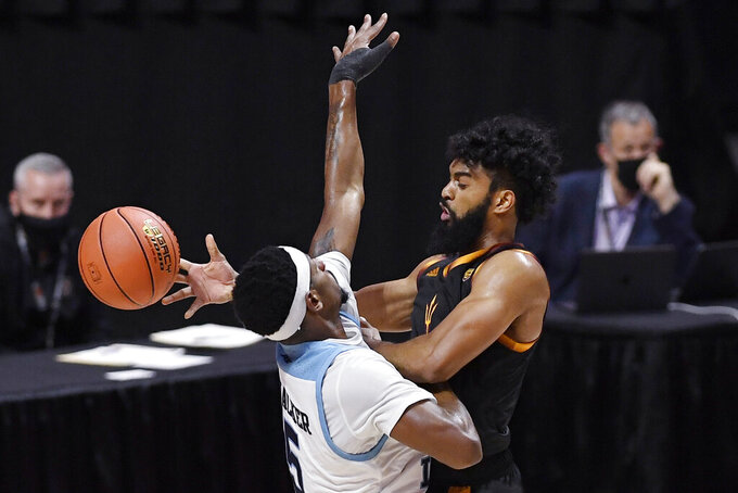 Arizona State's Remy Martin, right, passes as Rhode Island's Antwan Walker, defends in the second half of an NCAA college basketball game, Wednesday, Nov. 25, 2020, in Uncasville, Conn. (AP Photo/Jessica Hill)