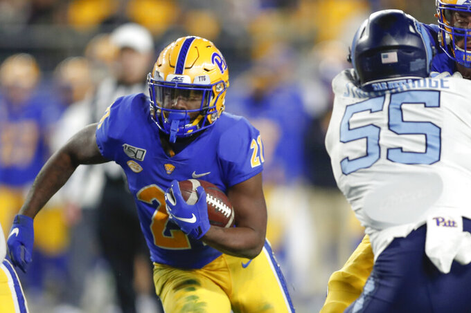 Pittsburgh running back A.J. Davis (21) runs the ball toward North Carolina defensive lineman Jason Strowbridge (55) during the first half of an NCAA football game, Thursday, Nov. 14, 2019, in Pittsburgh. (AP Photo/Keith Srakocic)