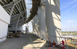 A construction worker eats lunch on the floor of the east concourse around the outside of SoFi Stadium in Inglewood, Calif., on Wednesday, Jan. 22, 2020. The estimated $5 billion project is on schedule to open in July as the most expensive stadium in NFL history. (AP Photo/Greg Beacham)