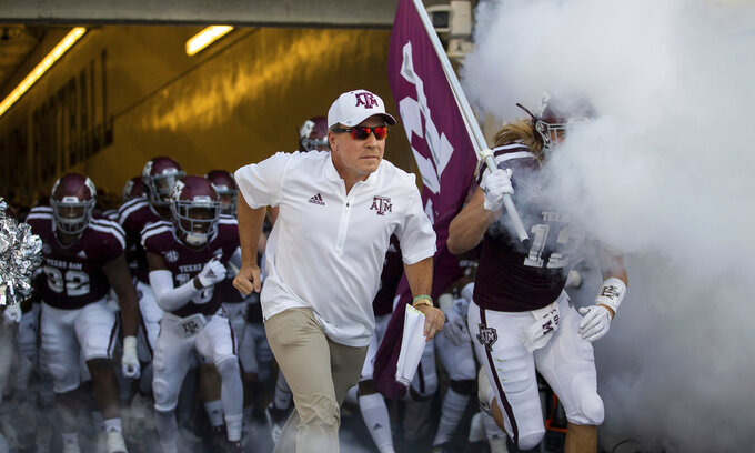 Texas A&M  coach Jimbo Fisher leads the Aggies onto Kyle Field for an NCAA college football game against Northwestern State on Thursday, Aug. 30, 2018, in College Station, Texas. (AP Photo/Sam Craft)