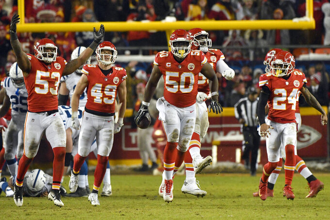 Kansas City Chiefs players celebrate after linebacker Justin Houston (50) recovered a ball fumbled by Indianapolis Colts quarterback Andrew Luck for a turnover, during the second half of an NFL divisional football playoff game in Kansas City, Mo., Saturday, Jan. 12, 2019. (AP Photo/Ed Zurga)