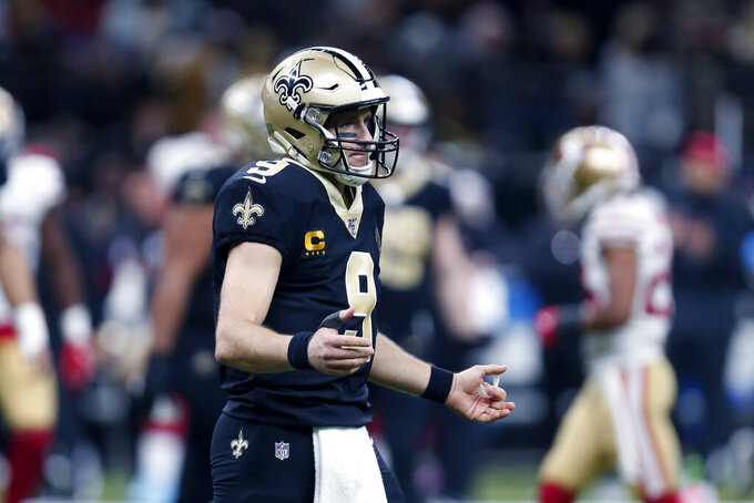 New Orleans Saints quarterback Drew Brees (9) reacts after a fumble by Alvin Kamara in the first half an NFL football game against the San Francisco 49ers in New Orleans, Sunday, Dec. 8, 2019. (AP Photo/Butch Dill)