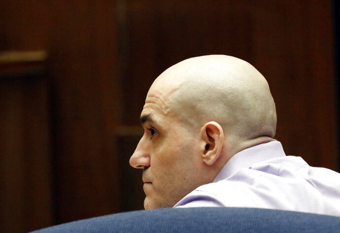 FILE - In this Aug. 15, 2019 file photo Michael Gargiulo listens as his guilty verdicts on all counts are read in Los Angeles Superior Court. A Los Angeles jury will decide whether a man prosecutors have dubbed