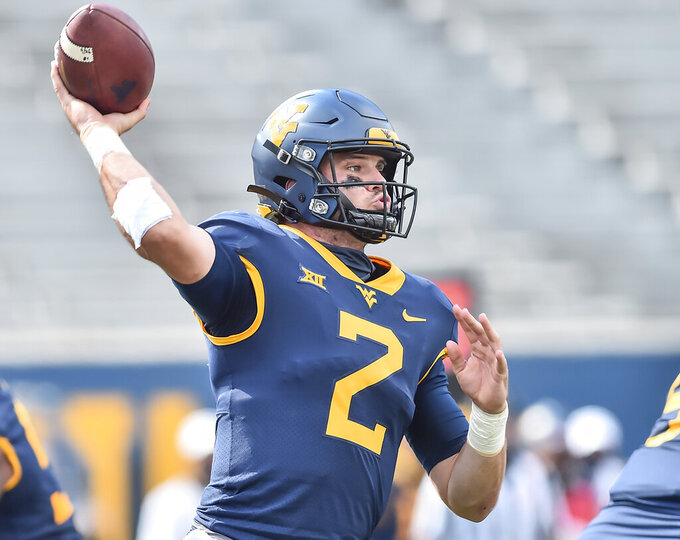 West Virginia quarterback Jarret Doege (2) makes a pass against Baylor during an NCAA college football game, Saturday, Oct. 3, 2020, in Morgantown, W.Va. (William Wotring/The Dominion-Post via AP)