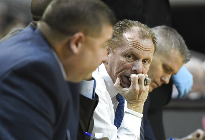 North Florida coach Matthew Driscoll talks to staff on the bench during the first half of the team's NCAA college basketball game against Auburn on Saturday, Dec. 29, 2018, in Auburn, Ala. (AP Photo/Julie Bennett)