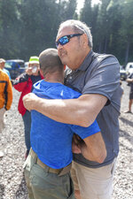 John Eller, right, hugs rescue lead Javier Cantellops at the Makawao Forest Reserve base camp on Saturday, May 25, 2019 in Wailuku, Maui. The Maui News reported Friday Amanda Eller was found injured in the Makawao Forest Reserve. Family spokeswoman Sarah Haynes confirmed she spoke with Eller's father John. Eller was airlifted to safety. (Bryan Berkowitz/Honolulu Star-Advertiser via AP)