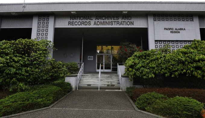 FILE - This Jan. 23, 2020, file photo shows the National Archives in the Sand Point neighborhood of Seattle that has about a million boxes of generally unique, original source documents and public records. In an announcement made Thursday, April 8, 2021, the Biden administration has halted the sale of the federal archives building in Seattle, following months of opposition from people across the Pacific Northwest and a lawsuit by the Washington Attorney General's Office. Among the records at the center are tribal, military, land, court, tax and census documents. (Alan Berner/The Seattle Times via AP, File)