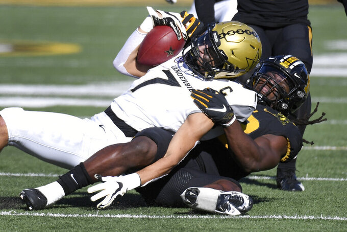 Vanderbilt wide receiver Cam Johnson (7) is pulled down by Missouri linebacker Nick Bolton during the first half of an NCAA college football game Saturday, Nov. 28, 2020, in Columbia, Mo. (AP Photo/L.G. Patterson)