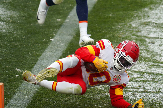 Kansas City Chiefs wide receiver Tyreek Hill scores a touchdown during the second half of an NFL football game against the Denver Broncos, Sunday, Oct. 25, 2020, in Denver. (AP Photo/Jack Dempsey)
