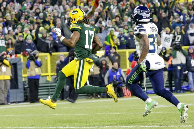Green Bay Packers' Davante Adams runs to the endzone for his touchdown catch during the second half of an NFL divisional playoff football game against the Seattle Seahawks Sunday, Jan. 12, 2020, in Green Bay, Wis. (AP Photo/Mike Roemer)