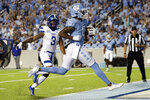 North Carolina wide receiver Emery Simmons (0) strides into the end zone for a touchdown past Georgia State safety Chris Bacon (3) during the first half of an NCAA college football game in Chapel Hill, N.C., Saturday, Sept. 11, 2021. (AP Photo/Chris Seward)