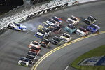 Jordan Anderson (3) hits the outside wall in Turn 4, starting a multi-truck collision during a NASCAR Truck Series race at Daytona International Speedway Friday, Feb. 15, 2019, in Daytona Beach, Fla. (AP Photo/Phelan M. Ebenhack)