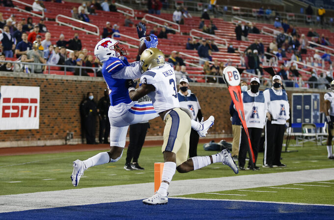 SMU wide receiver Rashee Rice (11) catches a pass for a touchdown as Navy cornerback Cameron Kinley (3) defends during the second half of an NCAA college football game Saturday, Oct. 31, 2020, in Dallas. (AP Photo/Brandon Wade)