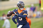 Denver Broncos quarterback Teddy Bridgewater takes part in drills at an NFL football training camp at team headquarters Saturday, July 31, 2021, in Englewood, Colo. (AP Photo/David Zalubowski)